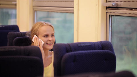 Woman talking on the phone being on the train Footage
