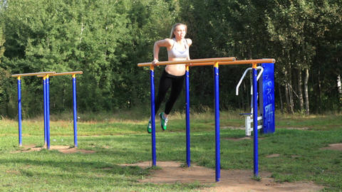 Girl training on parallel bars Stock Video Footage