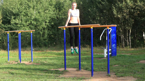 Girl training on parallel bars Footage