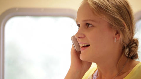 Woman talking on the phone in train Stock Video Footage