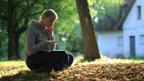 Young woman sitting on the ground outdoors Stock Video Footage