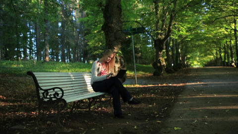 Young woman with laptop in the park Stock Video Footage