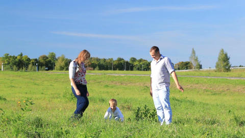 Family of three outdoors Stock Video Footage