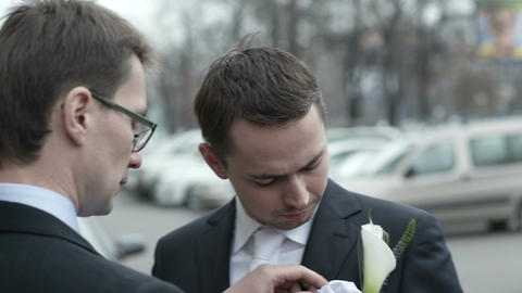 Groomsman fixing boutonniere Stock Video Footage
