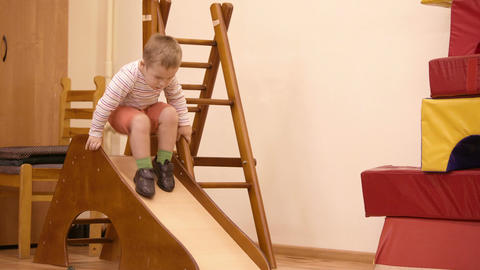 Boy playing in the nursery Stock Video Footage