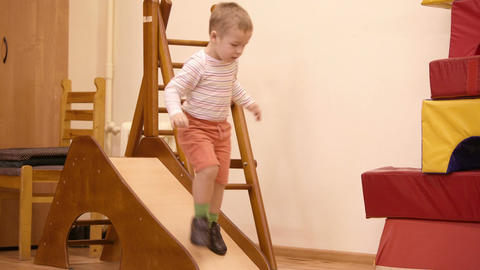 Boy playing in the nursery Footage