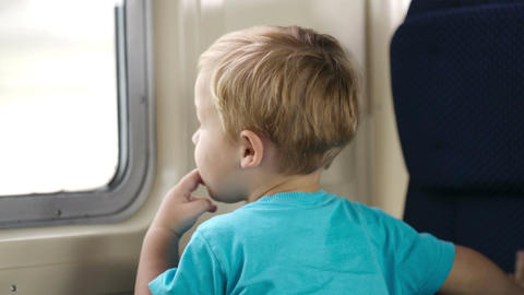 Little boy and his mother in the train Stock Video Footage