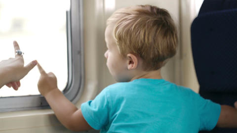 Little boy and his mother in the train Footage