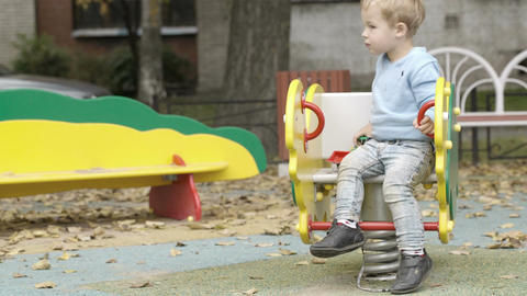 Little boy on the playground Stock Video Footage