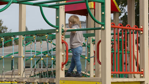 Boy on playground equipment Footage