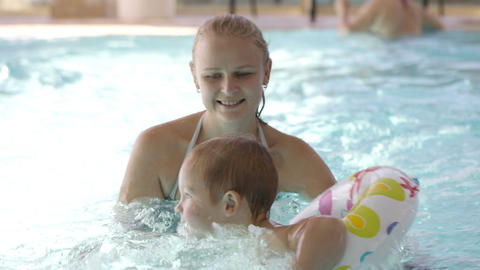 Little child having swimming lessons Stock Video Footage