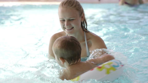 Little child having swimming lessons Footage