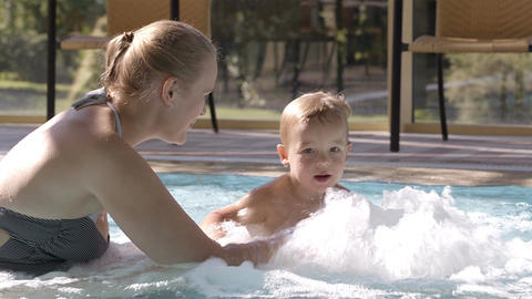 Mother And Her Son In The Swimming Pool stock footage