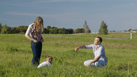 Family of three having fun outdoors Stock Video Footage