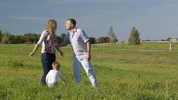 Family of three having fun outdoors Footage