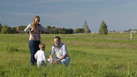 Family of three having fun outdoors Stock Video Footage