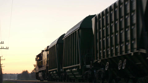 Freight train passing by in the countryside Stock Video Footage