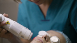 Doctor Doing A Fractional Skin Laser Treatment stock footage