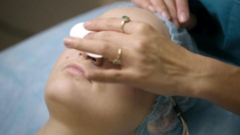 Woman being prepped in a skincare clinic Stock Video Footage