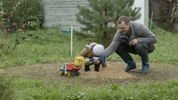 Father and son playing outdoors Stock Video Footage