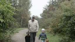 Grandad and grandson walking Stock Video Footage