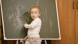 Creative little boy drawing on a chalkboard Stock Video Footage