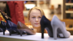 Young woman shopping for shoes Stock Video Footage