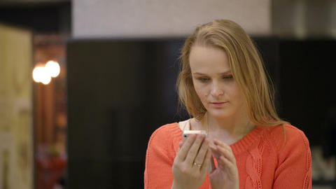 Young woman using smartphone Footage