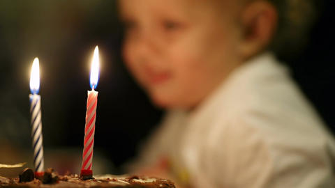 Little boy blowing out two candles on his birthday Stock Video Footage
