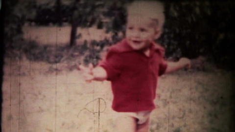 Boy playing ball. Vintage Stock Video Footage