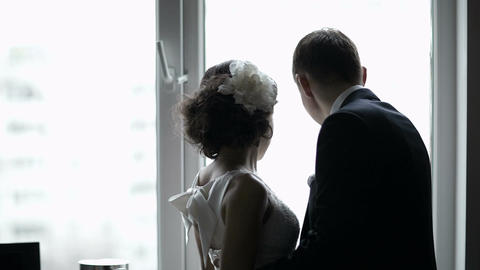Bridal pair looking out the window Footage
