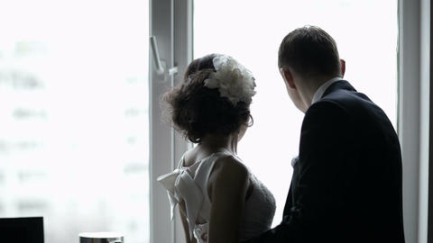 Bridal pair looking out the window Stock Video Footage