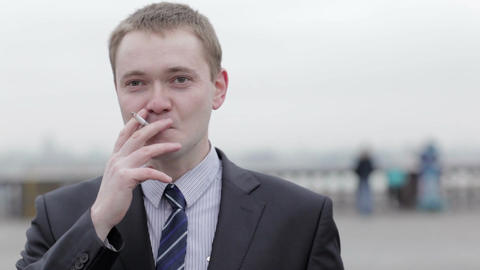 Businessman thinking while smoking a cigarette Stock Video Footage