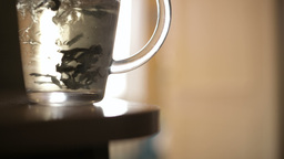 Pouring a mug of herbal tea Stock Video Footage