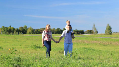 Family of three walking outdoor Stock Video Footage