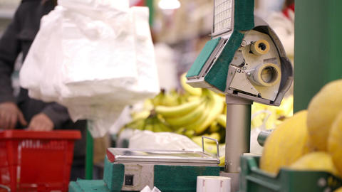 Weighing bananas in the shop Stock Video Footage