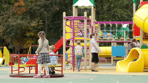 Children playing in an outdoor playground Stock Video Footage