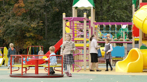 Children playing in an outdoor playground Footage