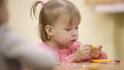 Little girl in the nursery Stock Video Footage