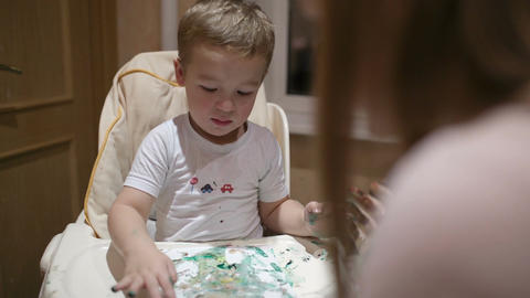 Mother and son painting Stock Video Footage