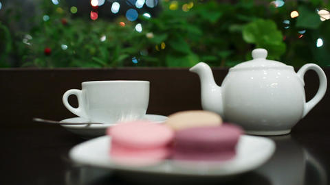 Tea with macaroons in cafe Stock Video Footage