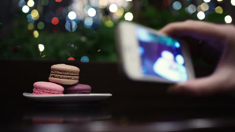 Taking a picture of macaroons Stock Video Footage