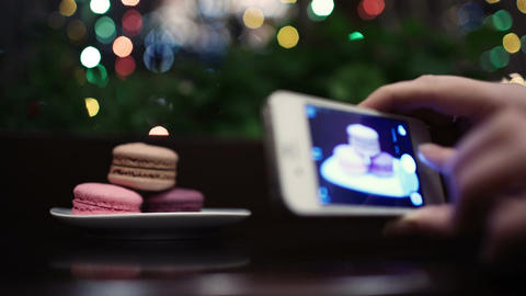 Taking a picture of macaroons Footage