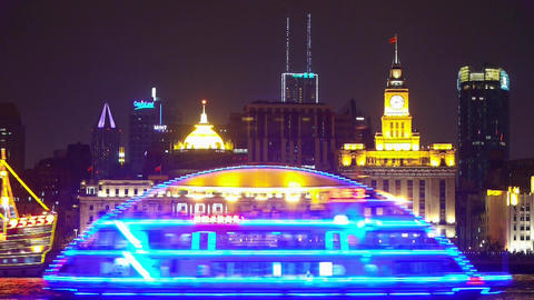 Brightly lit ships cruising Shanghai Bund at night,old style building Animation