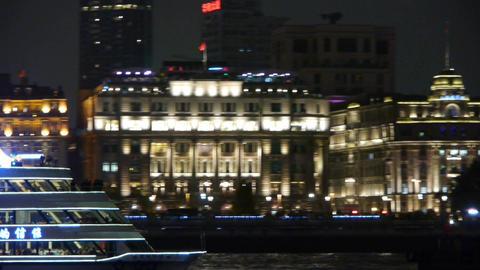 Brightly lit ships cruising Shanghai Bund at night,old style building Animation