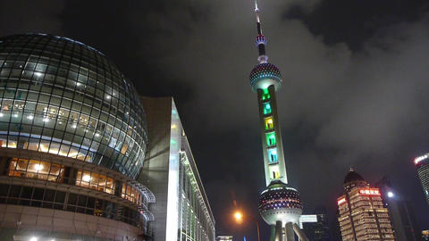 shanghai orient pearl TV tower at night,time lapse flying cloud Animation
