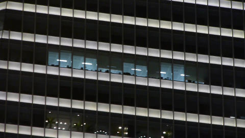 closeup skyscraper at night,urban morden business buildings district Animation