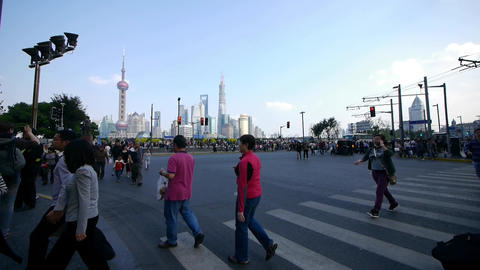 People Crossing The Road With Shanghai Lujiazui Bu stock footage