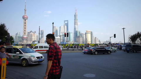 people crossing the road with Shanghai lujiazui business building Animation
