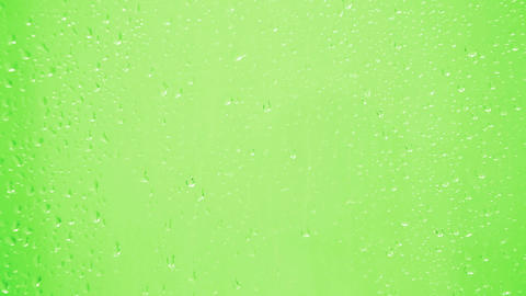 drops on glass - green background Stock Video Footage